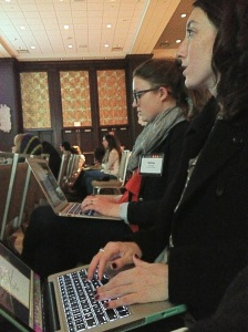 Kelsey and Katie typing notes at the College Media Association's Journalism Conference in NYC