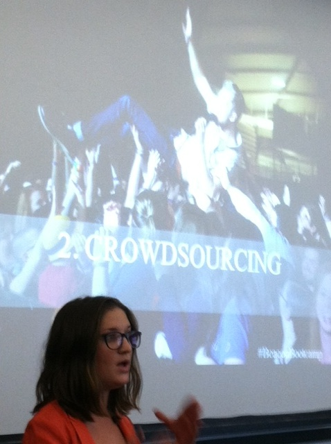 """Kelsey Thomas instructs staff how to use Twitter for journalism. """"Crowdsourcing. Not to be confused with crowdsurfing,"""" she said."""