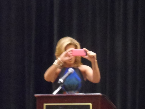 Hoda Kotb starts by taking a photo of the group for tweeting.