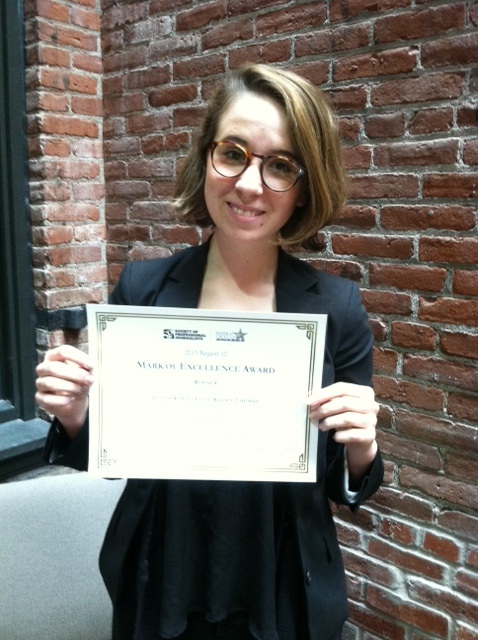 Olivia Alsept-Ellis with her First Place award for General News Reporting. The competition was among student newspapers in Oregon, Washington, Idaho, Montana and Alaska.