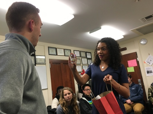 "Sports Editor Malika Andrews passes the ""torch"" to her successor, Hunter Jacobson"