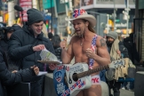The popular Naked Cowboy, A.K.A. Robert Burck, gets excited to sign a waiver for filming a segment for The Wendy Williams Show in Times Square. Connor Lorber, University of Portland (Nancy Copic); lorberconnor@gmail.com