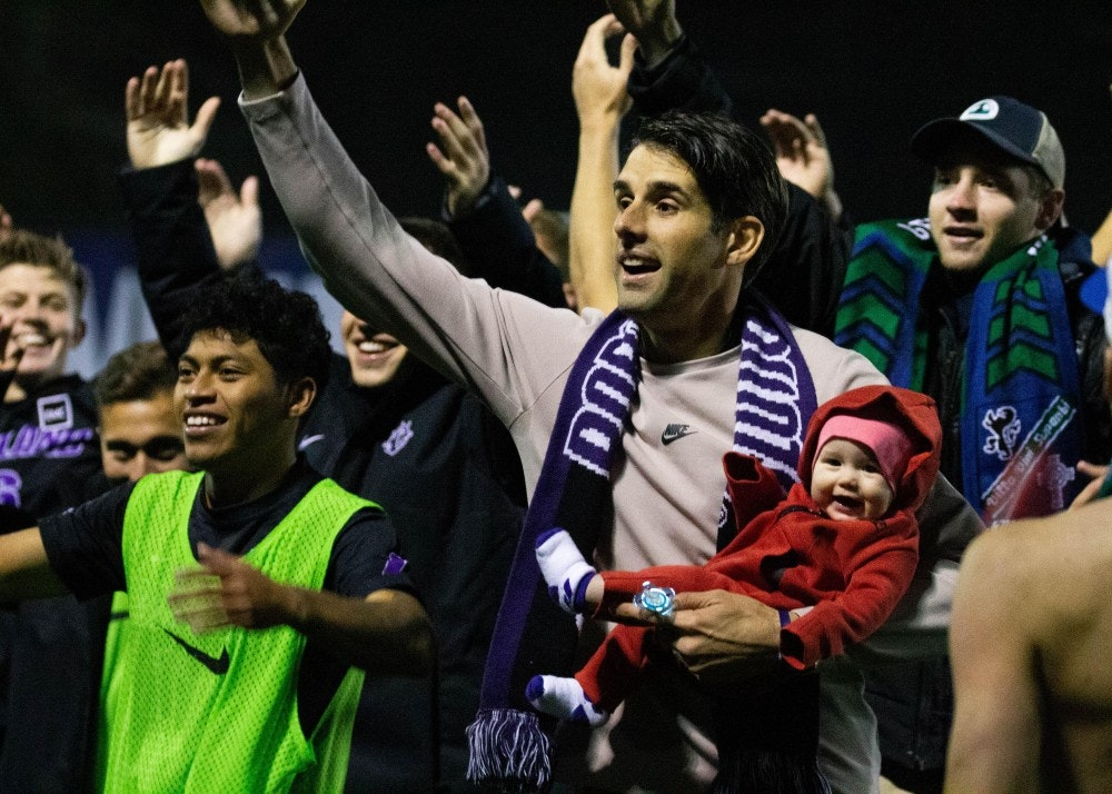 Photo soccer coach celebrates with baby- Molly Lowney